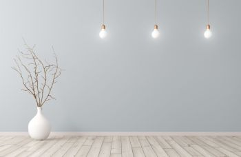 Empty room interior background, white vase with branch on the wooden floor and light bulbs ober blue wall 3d rendering
