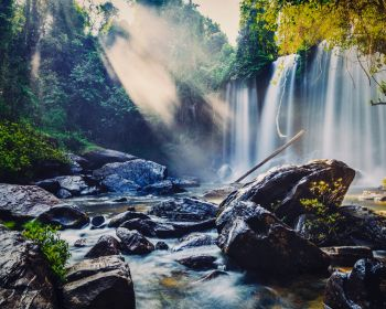 Vintage retro effect filtered hipster style image of tropical waterfall Phnom Kulen, Cambodia. Tropical waterfall in Cambodia