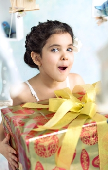 Surprised cute girl with birthday gifts
