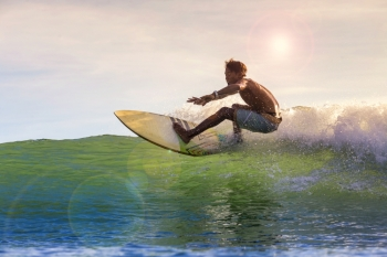 Surfing a wave, Bali, Indonesia.model released