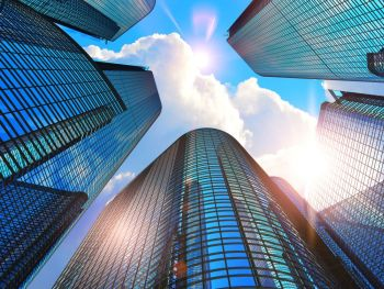 Downtown corporate business district architecture concept: 3D render illustration of the glass reflective office buildings skyscrapers against blue sky with clouds and sun light