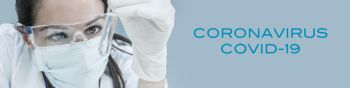 Panoramic web banner panorama header of female medical or research scientist or doctor wearing face mask looking at a test tube of clear solution in a Coronavirus COVID-19 lab or laboratory