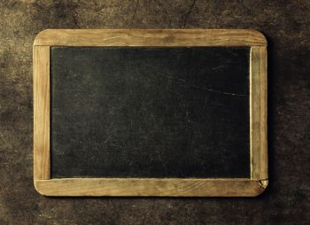 Blank chalkboard for your text. Top view over rustic table with copy space
