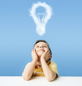 Little kid dreaming about a light bulb