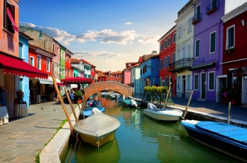 Bright colorful houses and water street in Burano, Italy