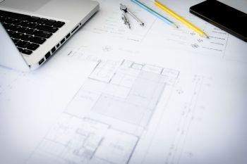 Construction equipment. Repair work. Drawings for building Architectural project, blueprint rolls and divider compass on table. Engineering tools concept. Copy space.