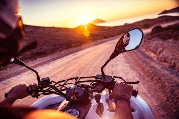 Travels on the bike, riding on the motorbike along Greece, active sportive summer adventure, driver enjoying summer vacation. Motorbike travels