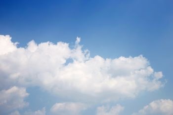 Blue sky background with cloud. Copy space