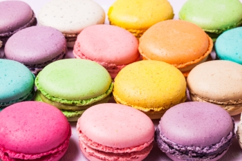 Colorful macaroons - french dessert as a background