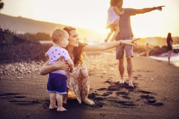 Happy, relaxed family on a tropical beach