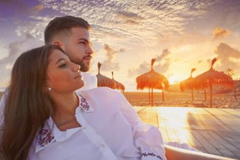 Couple young happy in beach vacation sunrise at Spain