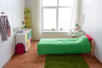 interior, home and furnishing concept - kids room with bed, table, rack and accessories. kids room interior with bed, table and accessories