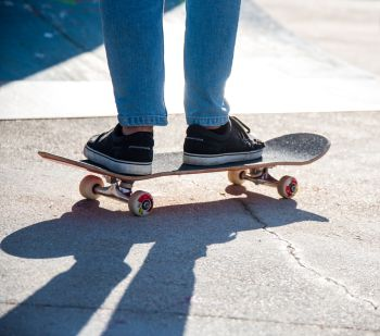 a Skater riding the skate  in a skate park only from the knee down