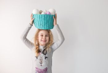 Little blonde girl holding basket with painted eggs. Easter day.. Little blonde girl holding basket with painted eggs. Easter day