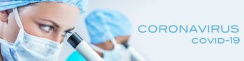 Panoramic web banner female medical or scientist wearing a face mask using a microscope in a research lab or laboratory with her colleague panorama with Coronavirus Covid-19 text