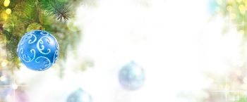 Christmas Background of Blue Balls on the Christmas Tree at the Defocused Lights Background with Copy Space