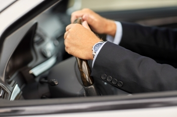 transport, business trip and people concept - senior businessman hands driving car. senior businessman hands driving car