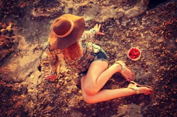 young woman wearing boho style clothes enjoy in summer day on the beach, retro colors