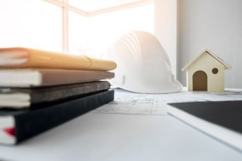 Construction equipment. Repair work. Drawings for building Architectural project, blueprint rolls and divider compass on table. Engineering tools concept with copy space