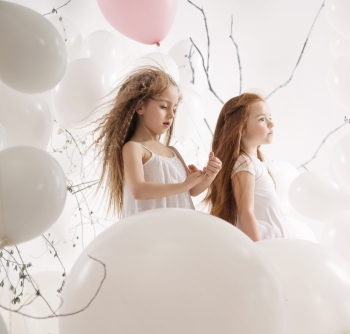 Two little girls among the balloons