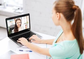 business, education and technology concept - woman or student having video call with customer service operator or teacher on laptop computer at home or office. woman or student having video call on laptop