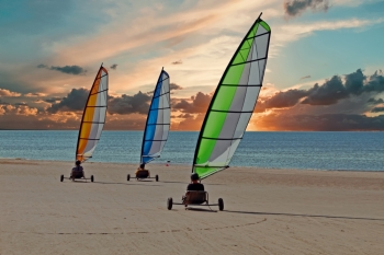 Sailing carts at the beach at sunset in the Netherlands
