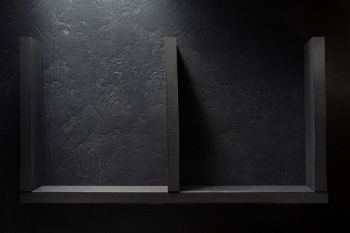 wooden shelf at black wall background