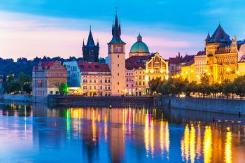 Scenic summer evening view of the Old Town ancient architecture and Vltava river pier in Prague, Czech Republic