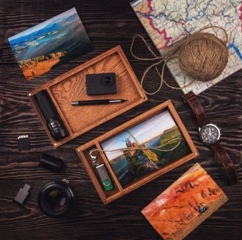 Wooden photo box with photo from travel. Decorated with different things. Travel concept.. Wooden photo box with photo from travel
