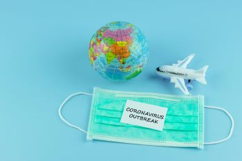 Protective face mask and airplane model on blue background, against Novel coronavirus (2019-nCoV) or Wuhan coronavirus and Influenza. Antiseptic, Hygiene and Healthcare concept