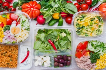 Various healthy salad in plastic packages for diet lunch, top view. Clean organic  food concept