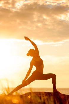 caucasian fitness woman practicing yoga. caucasian fitness woman practicing yoga at sunset