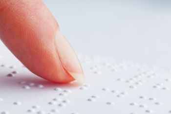 a book written in braille. braille for the blind.