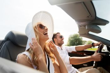 leisure, road trip, dating, couple and people concept - happy man and woman driving in cabriolet car outdoors. happy man and woman driving in cabriolet car