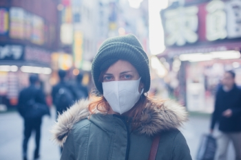 A young caucasian woman is wearing a face mask in Japan