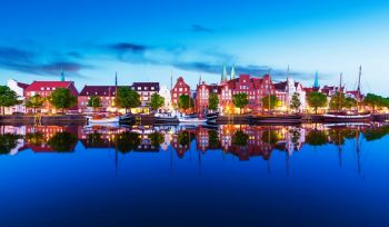 Scenic summer evening panorama view of the Old Town pier architecture in Lubeck, Germany