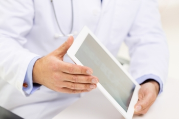 medicine, health care, people and technology concept - close up of f male doctor hands with tablet pc computer blank screen