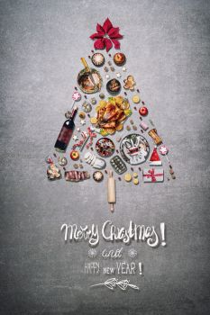 Merry Christmas greeting card with Christmas tree made with various Christmas foods for Christmas dinner