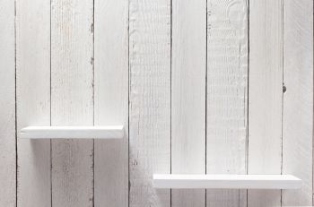 white shelf on wooden wall background texture