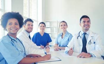 hospital, medical education, health care, people and medicine concept - group of happy doctors meeting at medical office. group of happy doctors meeting at hospital office